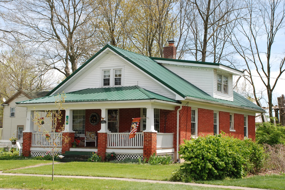 Redbrick Craftsman-style brick home with a beautifully manicured lawn