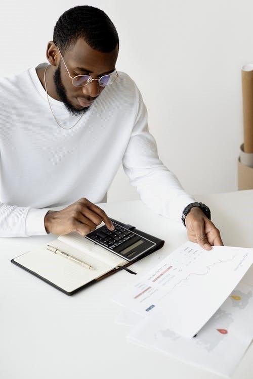 Man-White-Sweater-Calculator-Reports
